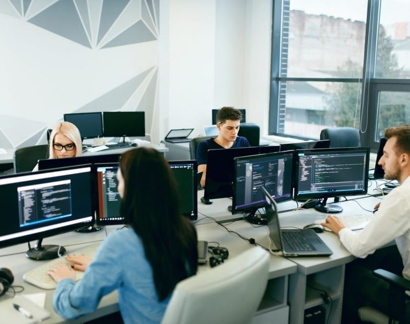 People,Working,In,Modern,Office.,Group,Of,Young,Programmers,Sitting